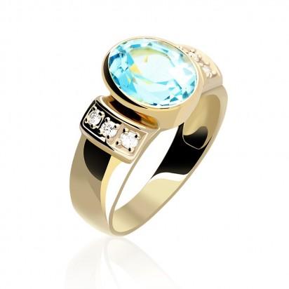 Złoty pierścionek wysadzany kamieniami szlachetnymi.