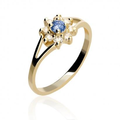Złoty pierścionek zawierający szafir,diament oraz brylant.