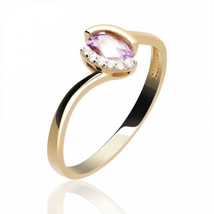 Pierścionek złoty z fioletową cyrkonią.