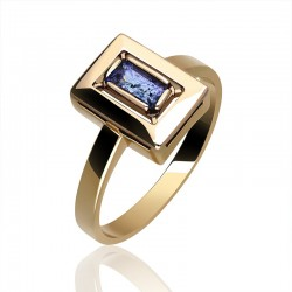 Imponujący złoty pierścionek z tanzanitem.