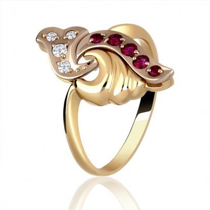 Pierścionek złoty wysadzany rubinami oraz diamentami.