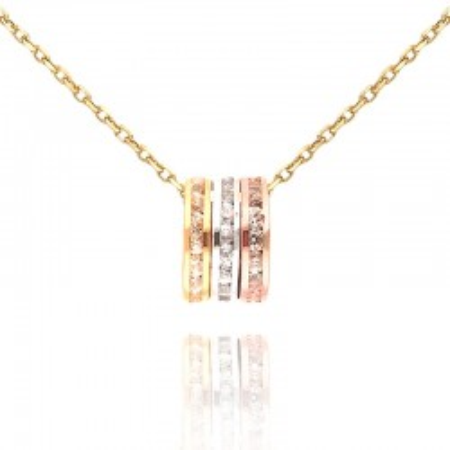 Złota zawieszka w trzech kolorach złota.
