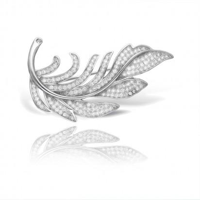 Broszka srebrna na kształt liścia wysadzana białymi oczkami
