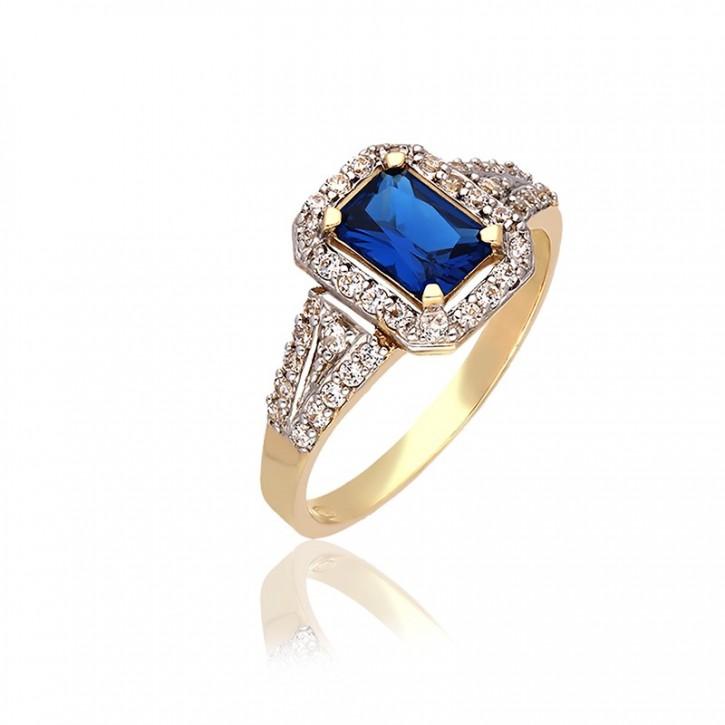 Pierścionek złoty z niebieską cyrkonią.
