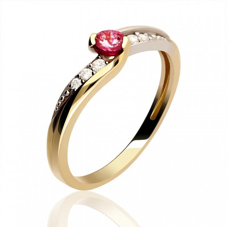 Złoty pierścionek z czerwonym rubinem.